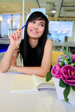 Asian business woman writing a note in the office Stock Photo