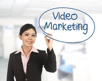 Asian business woman writing video marketing Royalty Free Stock Photo