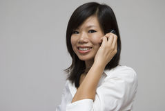 Asian business women. Asian business woman on a phone royalty free stock image