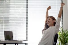Free Asian Business Women Are Relaxed From Working On A White Desk In The Office Stock Image - 183700311
