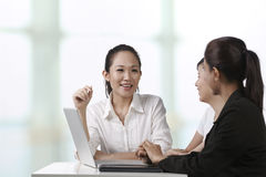 Asian business women having a meeting Stock Photos