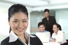 Asian business women with her team. Stock Photos