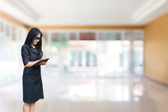 Asian business women standing and writing down on note book Royalty Free Stock Images