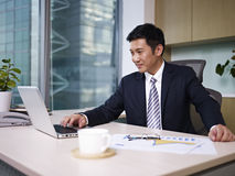 Asian businessman. Working on laptop computer in office Stock Images