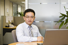 Asian businessman. Sitting in office Royalty Free Stock Photos