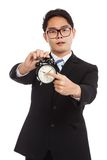 Asian businessman angry point to alarm clock Stock Images