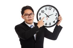 Asian businessman angry point to a clock Stock Images