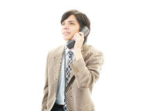 Asian businessman answering the phone Royalty Free Stock Photo
