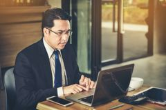 An Asian businessman is anxious about business with the information on his laptop. royalty free stock photo