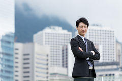 Asian businessman arm cross Royalty Free Stock Image