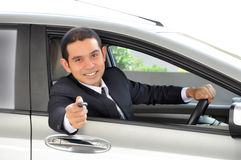 Asian businessman as a driver giving a car key Royalty Free Stock Image