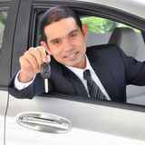Asian businessman as a driver giving a car key Royalty Free Stock Photo