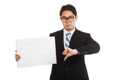 Asian businessman in bad mood  thumbs down hold blank sign Stock Photos