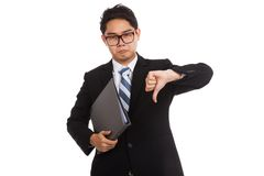 Asian businessman in bad mood  thumbs down hold folder Royalty Free Stock Photo