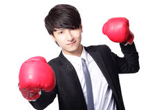 Asian businessman battle with boxing glove Royalty Free Stock Photos