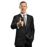 Asian businessman in black suit shows well done Stock Photography