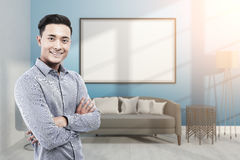 Asian businessman in blue room with whiteboard Stock Photos