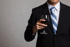 Asian businessman body with glass of red wine Stock Photos