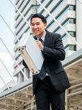 Asian businessman bowing back, respect or apology Royalty Free Stock Photo