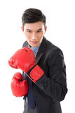 Asian businessman with boxing gloves Stock Photos