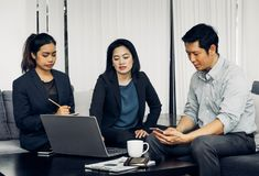 Asian businessman and businesswoman working togerther in office,Teamwork concept stock images