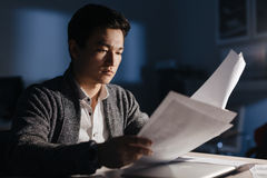 Asian Businessman Busy Working at Night royalty free stock photography