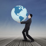 Asian businessman carrying the earth Stock Images