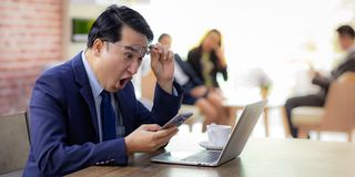 Asian Businessman celebrate in cafe royalty free stock photos