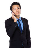 Asian businessman chat on cellphone Stock Images