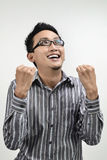 Asian businessman cheering Royalty Free Stock Photos