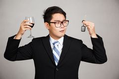 Asian businessman choose drink or drive Royalty Free Stock Photo
