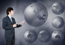 Asian Businessman choosing Europe continent, business concept of Royalty Free Stock Photos