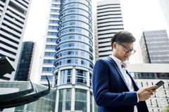 Asian businessman in a city royalty free stock photo