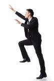 Asian businessman climbing Stock Photos
