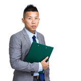 Asian businessman with clipboard Royalty Free Stock Image