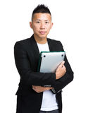 Asian businessman with clipboard and laptop computer Royalty Free Stock Photos
