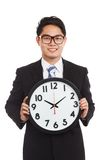Asian businessman with a clock Royalty Free Stock Images