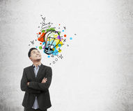 Asian businessman and colorful light bulb sketch Royalty Free Stock Photography