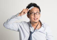 Asian businessman combing hair Royalty Free Stock Photos