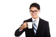 Asian businessman with a cup of coffee Stock Photos