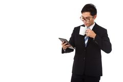 Asian businessman with a cup of coffee and tablet PC Stock Image