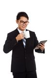 Asian businessman with a cup of coffee and tablet PC Royalty Free Stock Photo
