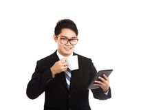 Asian businessman with a cup of coffee and tablet PC Stock Photography