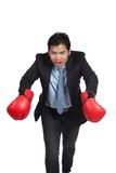 Asian businessman do  funny pose  with red  boxing glove Royalty Free Stock Photography