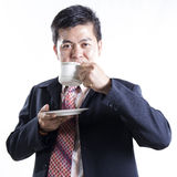 Asian Businessman drink the coffee Stock Photography