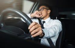 Asian businessman driving. A car stock photo