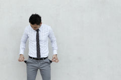 Asian Businessman with empty pockets Stock Photo