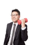Asian businessman exercise with a dumbbell in his hand Stock Photography