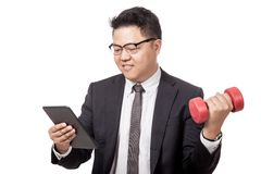 Asian businessman exercise while working Royalty Free Stock Photos
