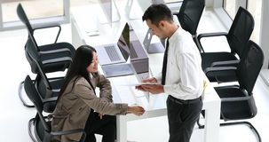 Asian businessman explain graph analysis. Asian businessman explain graph analysis to businesswoman in modern office, working together stock video